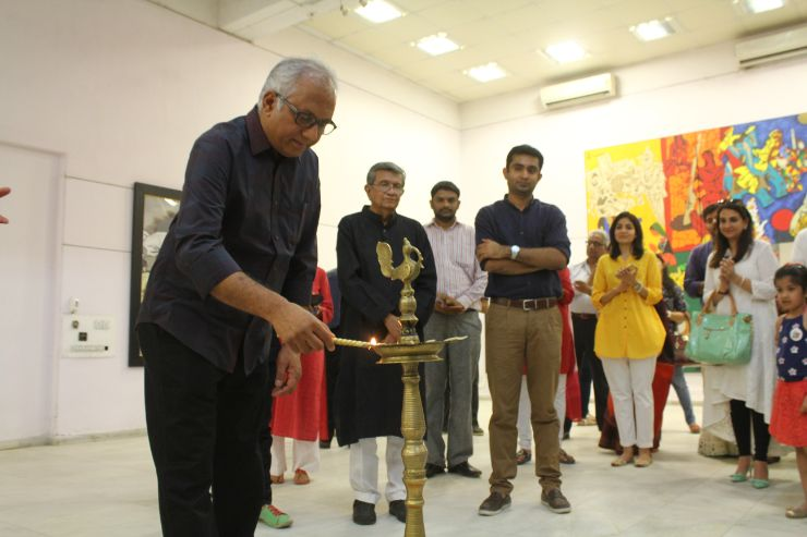 Shri Atul Dodiya lighting the lamp of M F Husian's Art Exhibition, Art-Show