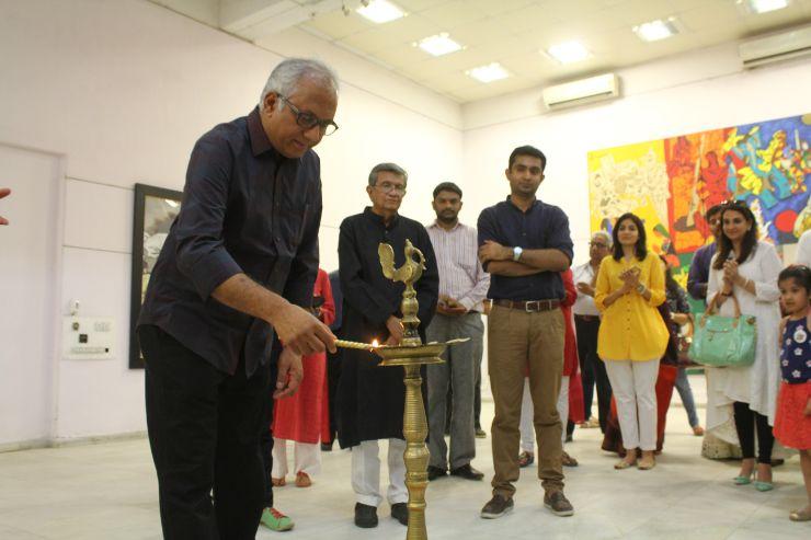 Shri Atul Dodiya lighting the lamp of M F Husian's Art Exhibition, Art-Show