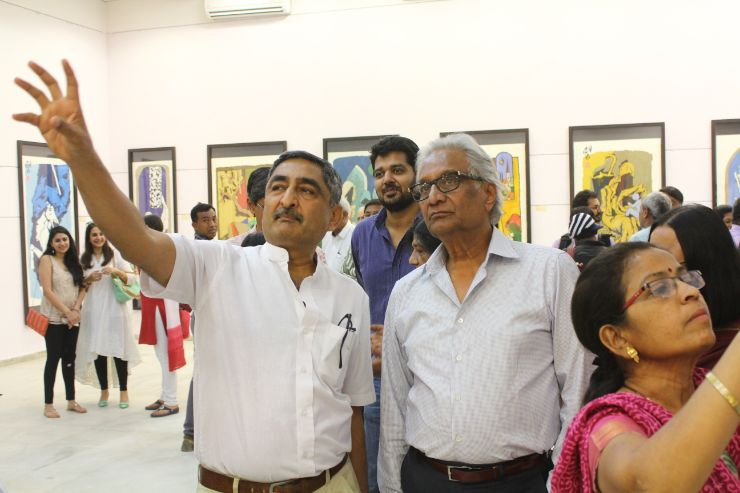 Shri Anil Relia explaining the work to an appreciator At M F Husain's Art Exhibition