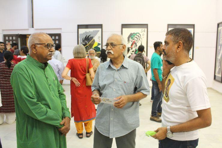 Shri Bharat Panchal, Shri Amrut Patel and Shri Kalpit Panchal at M F Husain,s Art exhibition