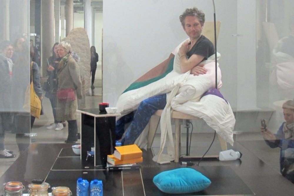 Artist Abraham Poincheval, Human Hen Incubates Eggs, Paris Art Museum