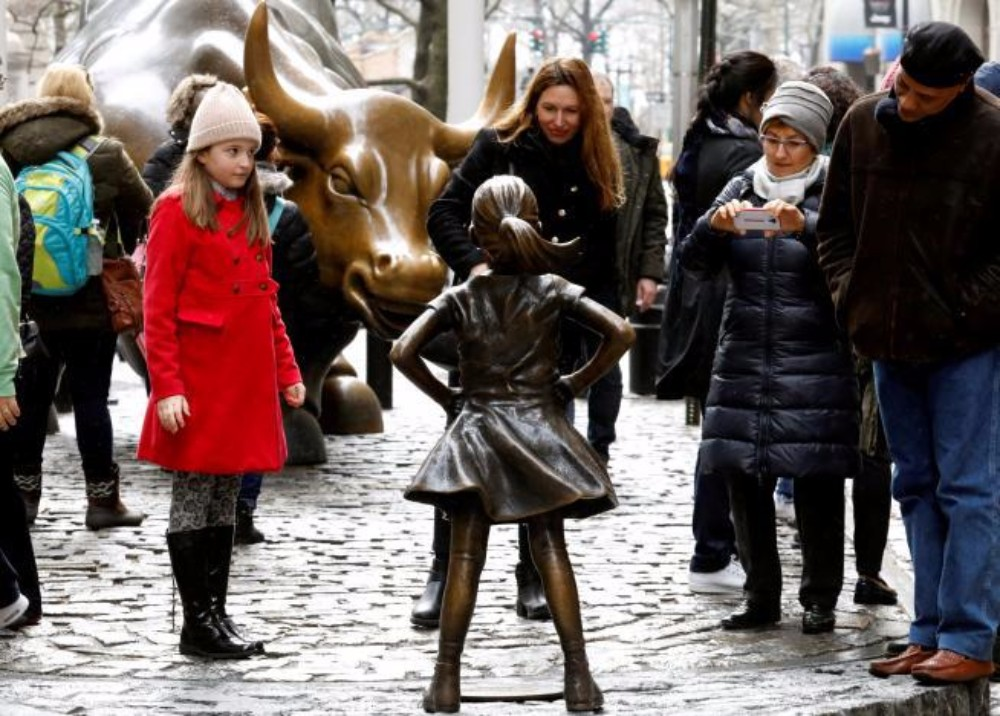 Fearless Girl challenges the Charging Bull of Wall Street