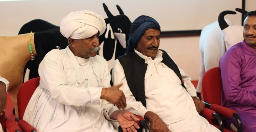 two-pastoralists-from-banni-kucchh-talking-about-their-life-issues-at-living-lightly-journeys-with-pastoralists-exhibition