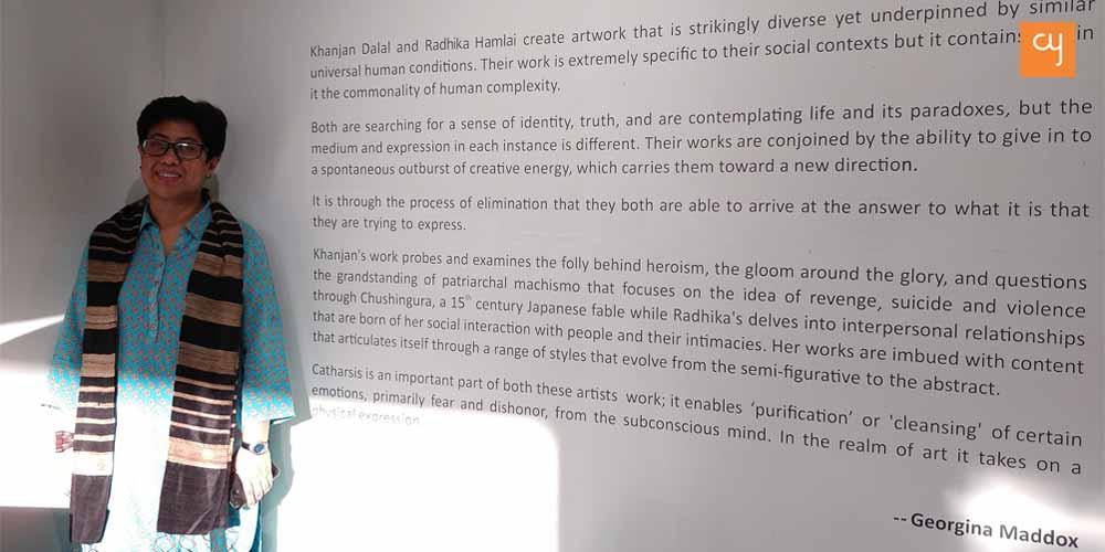 The curator, Georgina Maddox alongside the curator's note
